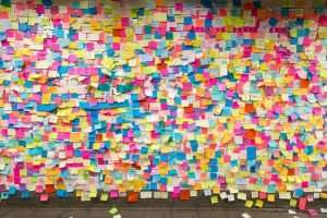 Sticky post-it notes on wall in Union Square subway station in NYC